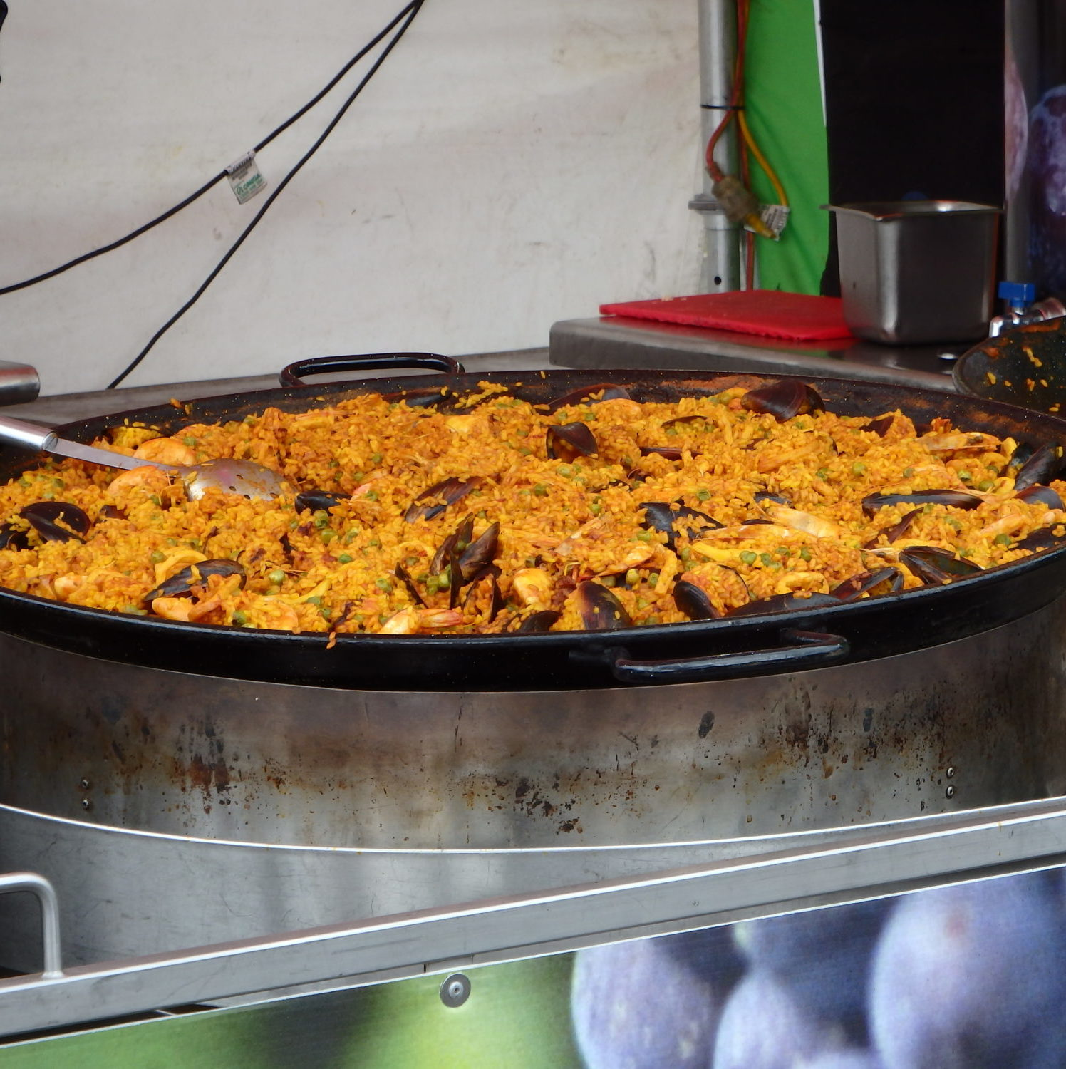 Delicious Paella sizzling in large pan