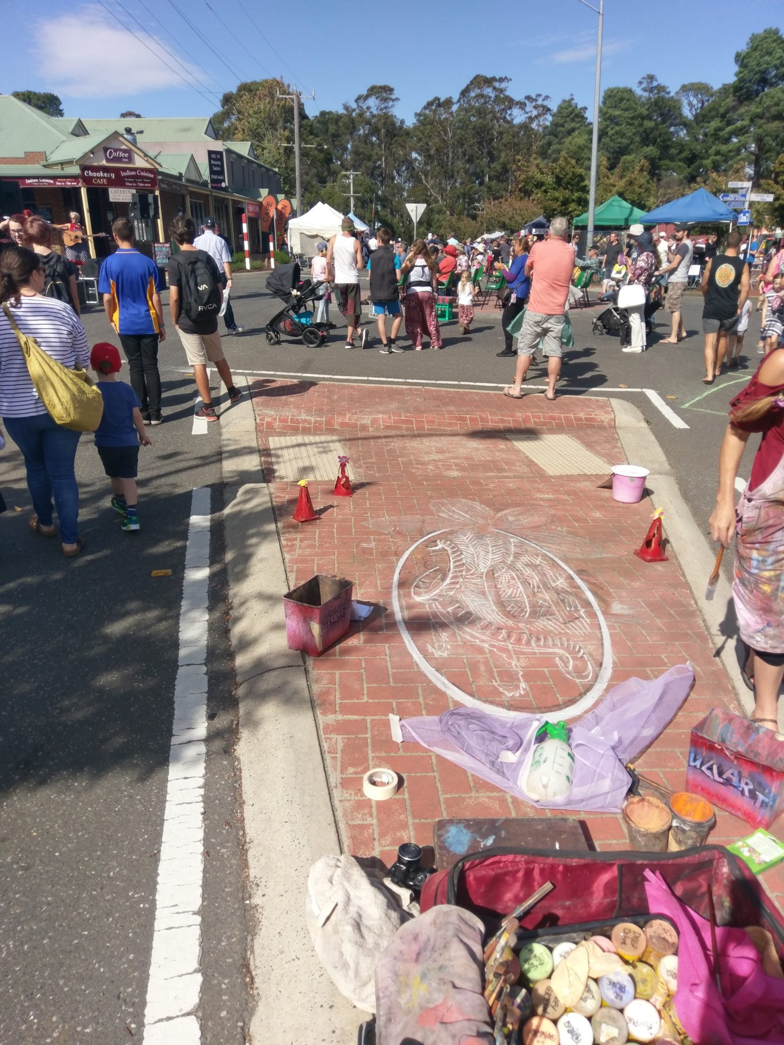 Artist decorating the streets of Emerald