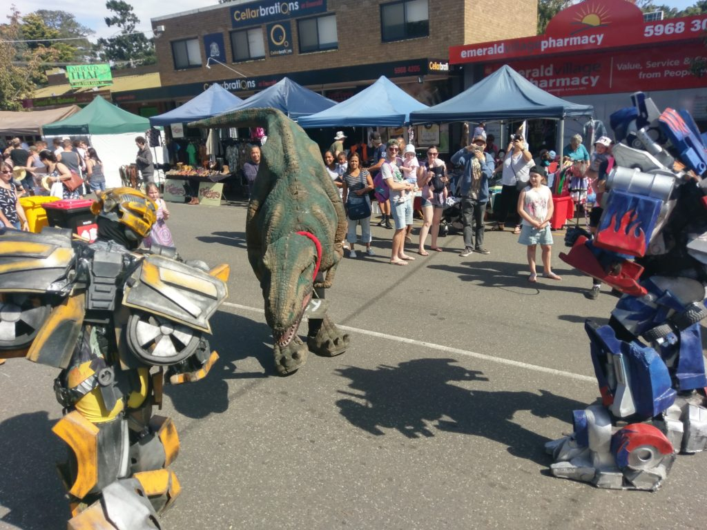 Dinosaur battles Transformers in Funfest main street